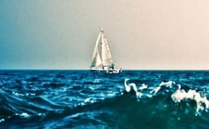 sailboat in rough water